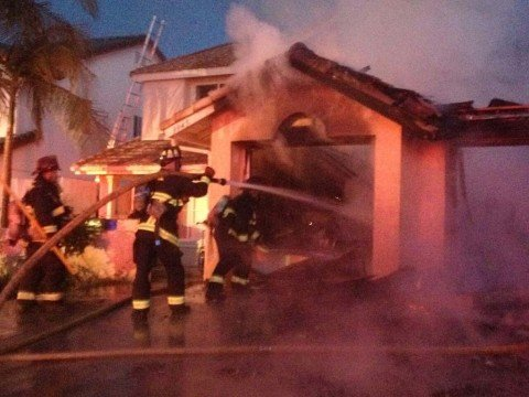 Fire displaces couple, garage destroyed