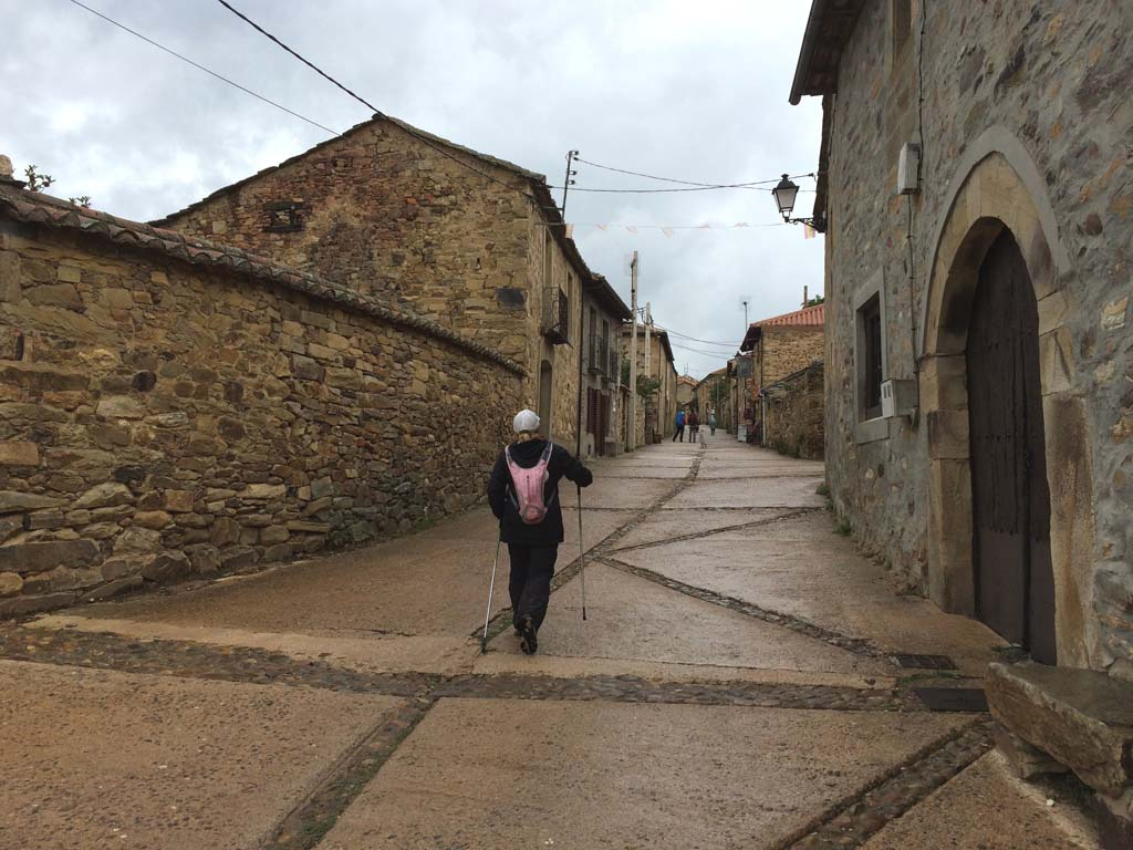 "Peggy O'Shea of San Marcos makes her way up a pebbled street in Rabanal del Camino, a village about two-thirds of the way to Santiago, the end of the 500-mile pilgrimage.  ""We left there at 5:30 a.m.,"" Tim O'Shea remembers. ""It was a long day because of the terrain. Rabanal is very old and very pretty, but very rustic."""