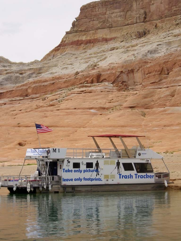 Volunteers with Trash Trackers, who clean the 1,960 miles of Lake Powell's shoreline, stay on houseboats for five to seven days. The boats are donated by Lake Powell Resorts & Marinas.