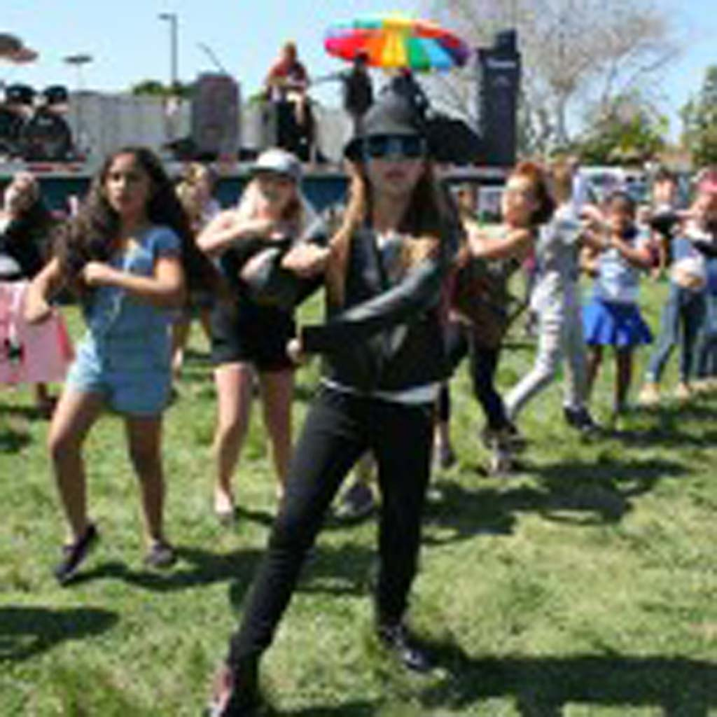 Ryanne Davis, 10, of Oceanside, leads fellow South Oceanside Elementary students in a flash mob dance. Live music, a kids' game area, and vender and food booths were also part of the fun. Photo by Promise Yee