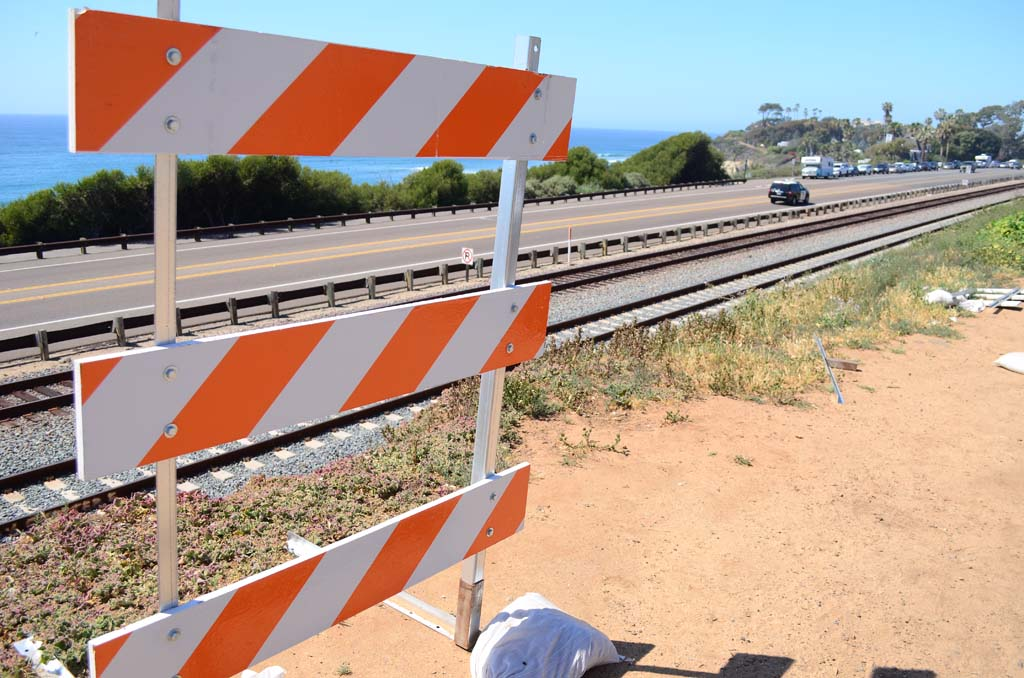 The North County Transit District is keeping the barriers along the bluff on San Elijo Avenue up as a safety measure. File photo