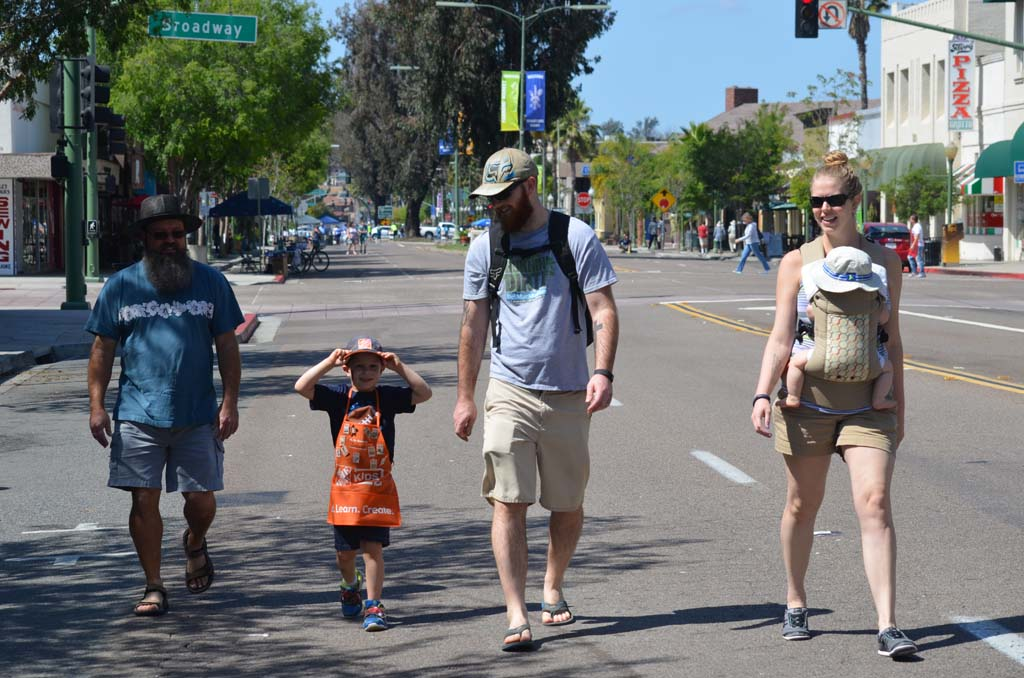 "From left: Scott Yoder, Joshua Hall, Robert Hall, Ahna Hall with 8-month-old Kieran Hall walk down Grand Avenue. ""It's not everyday you get to walk down the streets like this,"" Ahna said. Photo by Tony Cagala"