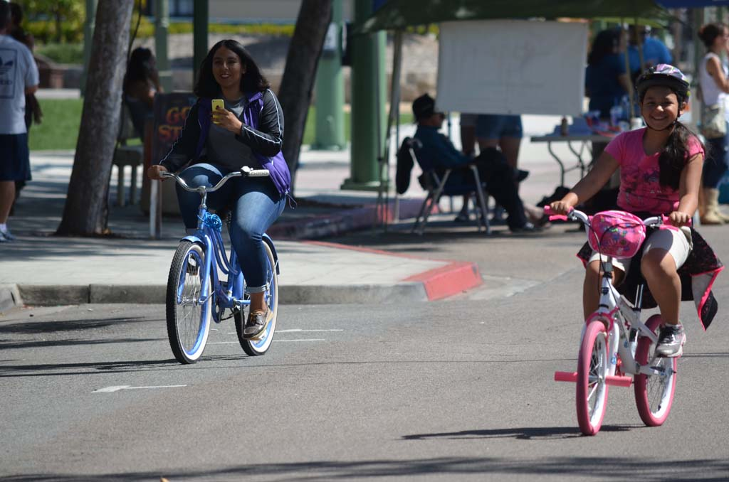 Andrea Fonseca, right, and Sarai Fonseca ride their bikes down a stretch of Grand Avenue in Escondido. Photo by Tony Cagala