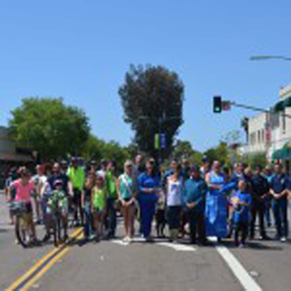 People attending the city's first-ever CicloviaEscondido event on Saturday take part in a group photo. Photo by Tony Cagala