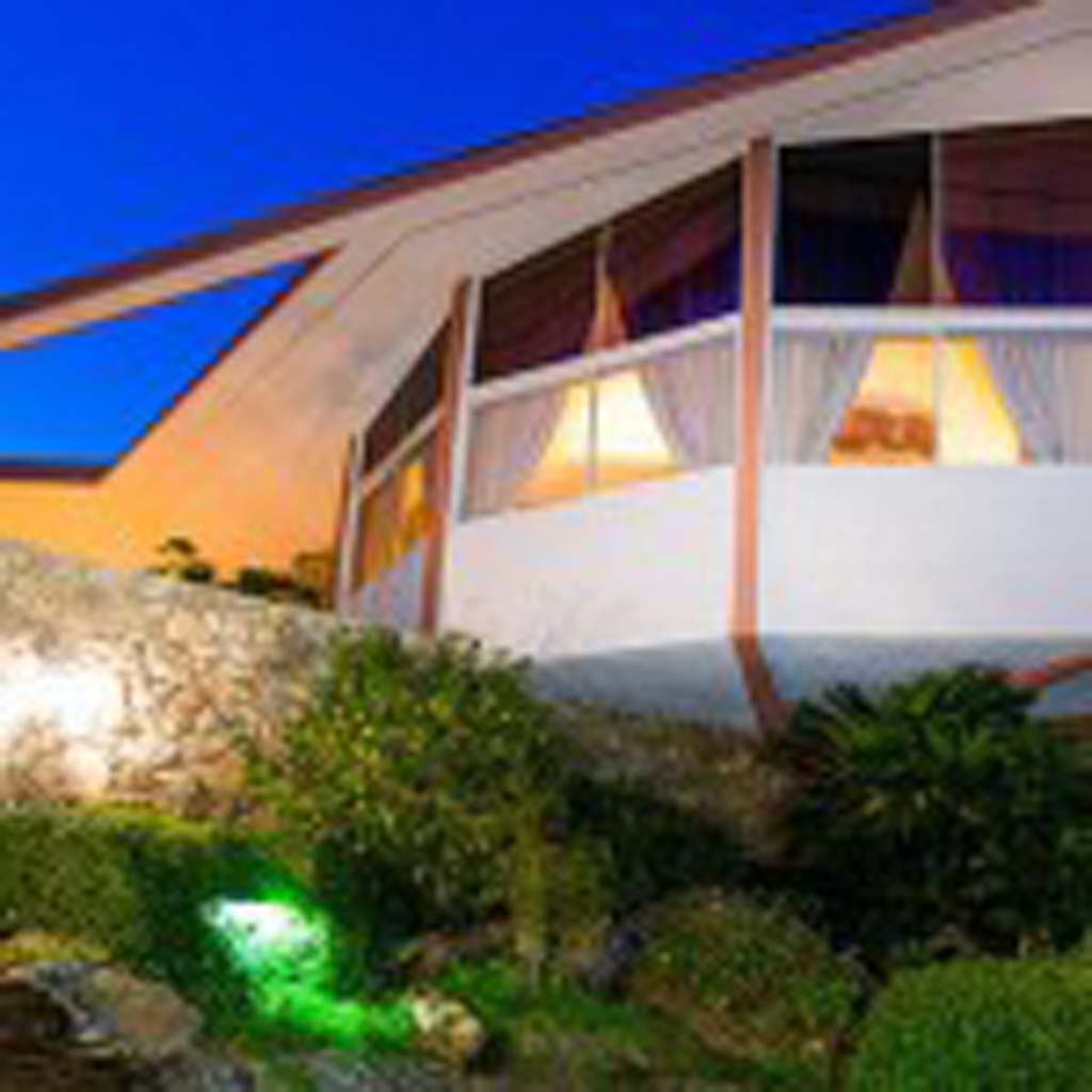 """This mid-century modern home at 1350 Ladera Circle in """"upper"""" Old Las Palmas was Elvis' home for a year (rent: $21,000). He and Priscilla honeymooned here after their May 1967 wedding. The 5,000-square-foot home has four bedrooms and five bathrooms, and is built in """"four perfect circles on three levels,"""" according to the real estate listing. As of late 2014, the house was for sale for $8.5 million, marked down from $9.5 million. Tours are held on the weekends by guides dressed as Elvis and Priscilla. (Courtesy photo)"""