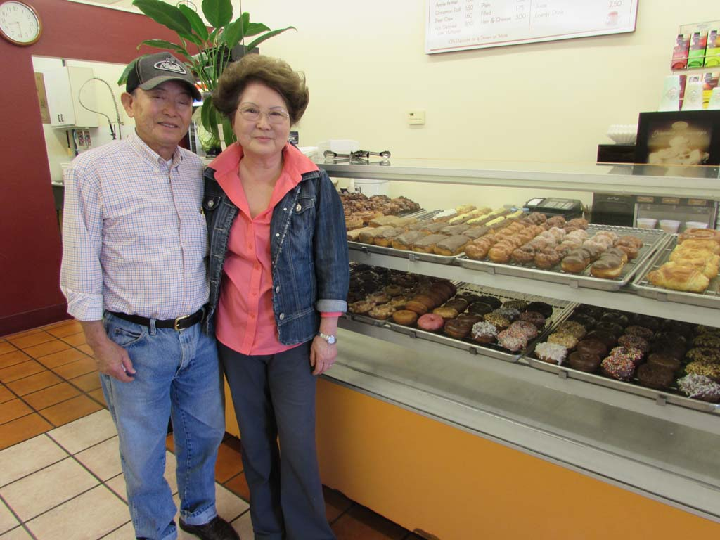 When Harry and Grace Kim opened The Donut Fair in 1977, a coffee cost 30 cents and a donut was 18 cents. After 38 years, the couple is ready to retire. Photo by Ellen Wright