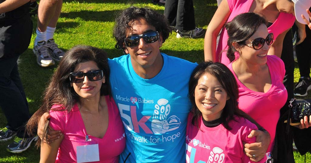 From left: Marjan Daneshmand, Dr. Sean Daneshmand and Marcela Lee, anchor from Channel 8 News who will be emceeing again this year at a previous Miracle Babies 5K event. Courtesy photo
