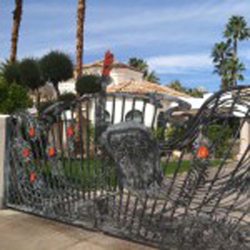 Jay Leno, in a nod to his long-time employer, NBC, had this peacock gate installed at his home in Old Las Palmas. The current owners decorate it for every season, according to local guide Kirk Bridgman. (E'Louise Ondash)