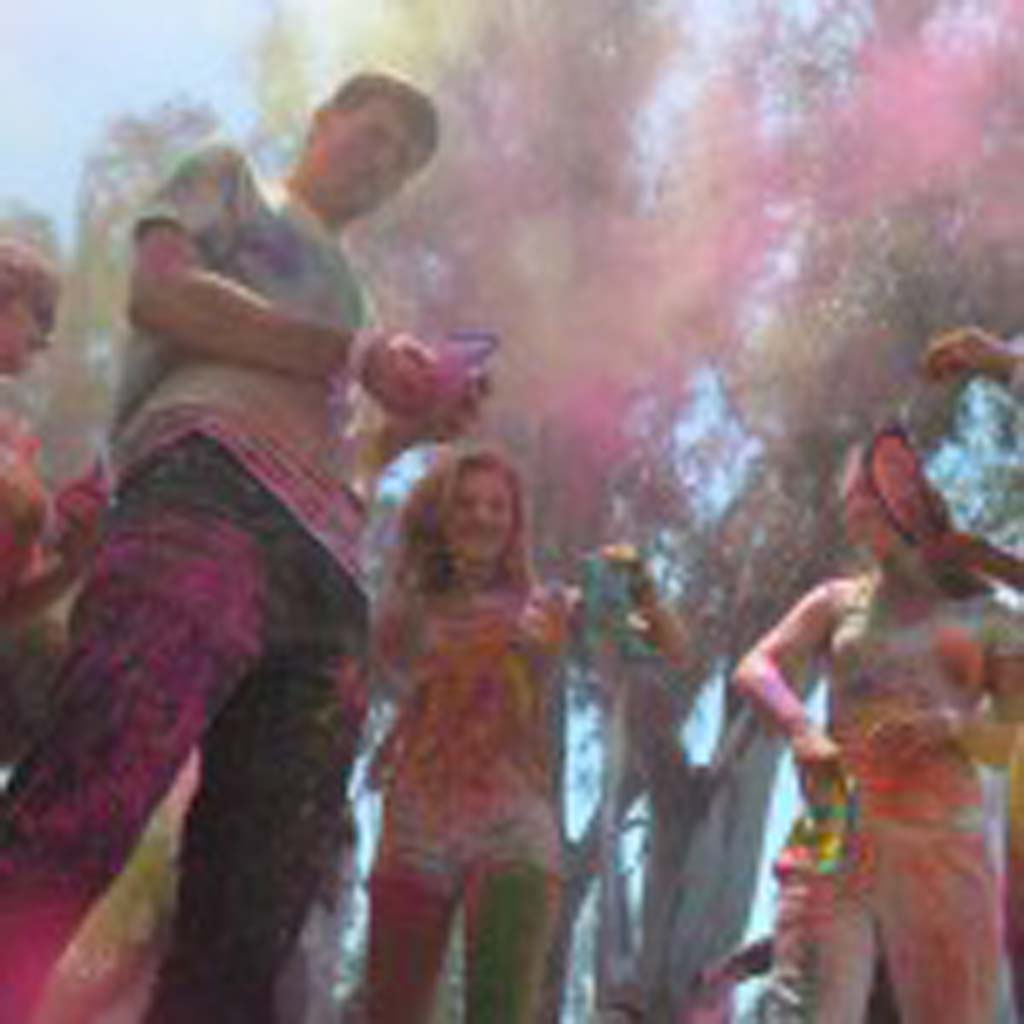 Revelers throw their worries to wind, in this case, colored cornstarch, to help celebrate the Indian tradition of Holi. Photo by Tony Cagala