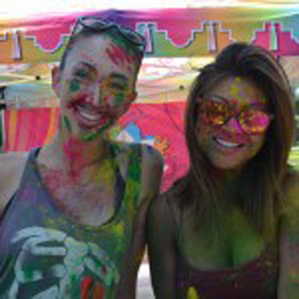 Dannie Fathman, left, and Tiffanie Damian at the Holi Festival of Colors at Escondido's Grape Day Park. Photo by Tony Cagala