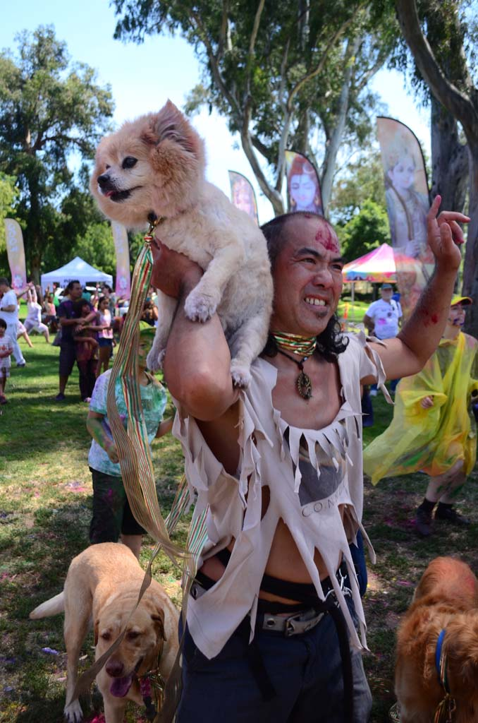 Zjar Uruluza, of Escondido, dances with Fox, one of his three dogs. Photo by Tony Cagala