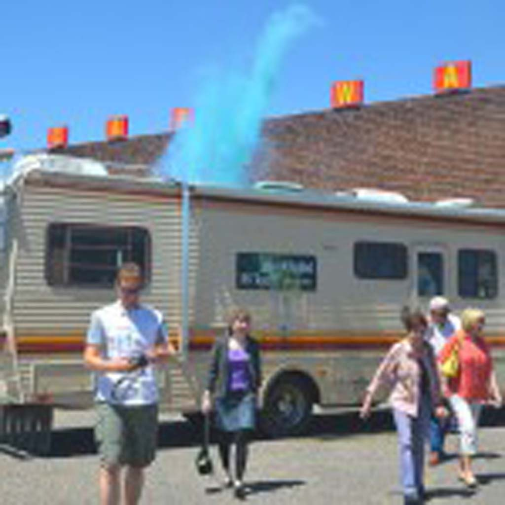 "Dylan Wisneski, tour assistant, sets off a blue smoke bomb to mimic a meth-cooking scene from the blockbuster TV series ""Breaking Bad."" Frank Sandoval, owner of Breaking Bad RV Tours, conducted a nationwide search for this 1986 Fleetwood Bounder, a duplicate of the two used in the TV series. One was gutted and a makeshift lab installed for the driving scenes; the other met its fate in the crusher (Season 3; Episode 6). The interior scenes were filmed on a set built in a box at an Albuquerque sound stage."