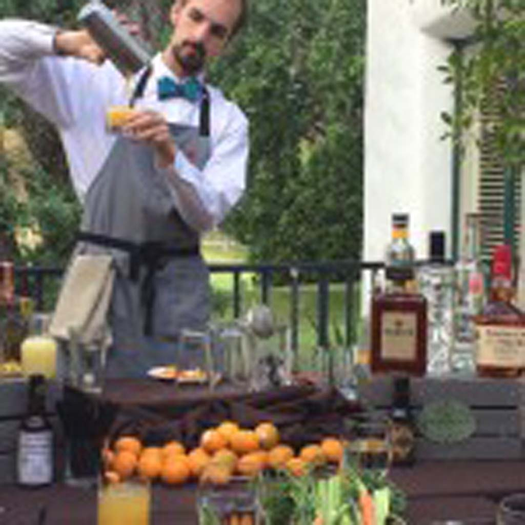 """Sam Gay, a native of Ojai and head bartender at the Ojai Valley Inn & Spa, conducts 'Pixology"""" classes during April. He teaches guests how to create Pixie tangerine-based libations like the Bourbon Pixie Rumble, which Gay and other local bartenders invented. Photo by E'Louise Ondash"""