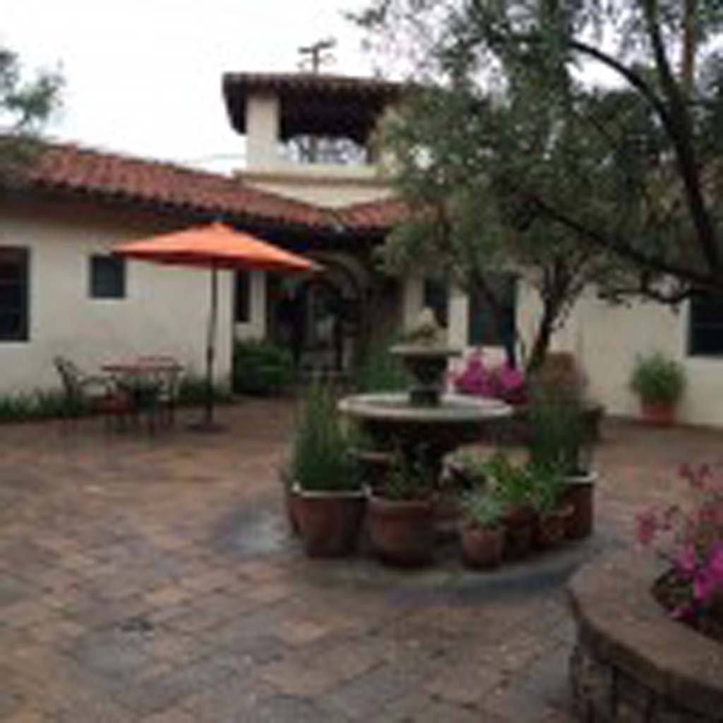 The inviting patio at Su Nido Inn is a welcome respite from the outside world. The inn is a short two blocks off Ojai Avenue, where many of the boutiques, galleries and eateries are. Built in the Mission Revival style, the inn's rooms are quiet, comfortable and cozy, and suites are equipped efficiency kitchens for extended stays. Photo by E'Louise Ondash