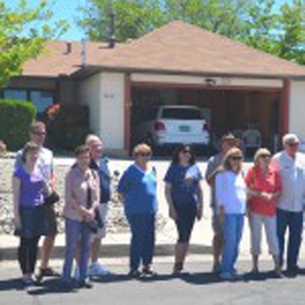 "Tourists are a common sight at the Albuquerque residence that served as Walter White's home in ""Breaking Bad."" Owner Fran Padilla says that as many as 200 cars a day pass by. This tour group, which includes visitors from London and Switzerland, lines up for a photo. The Breaking Bad RV Tour takes passengers to 17 Albuquerque locations, and has recently added locations from ""Better Call Saul,"" a popular ""Breaking Bad"" spinoff, currently filming Season 2."