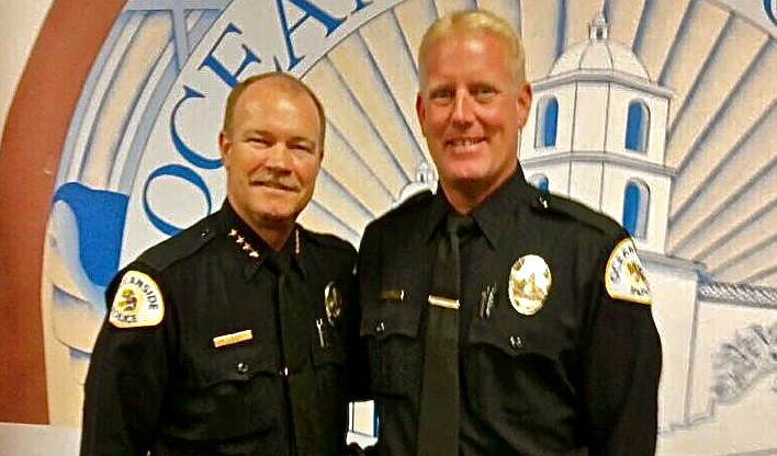 Oceanside Police Chief Frank McCoy with the city's newest hire, Officer Mike Hatfield. Courtesy photo