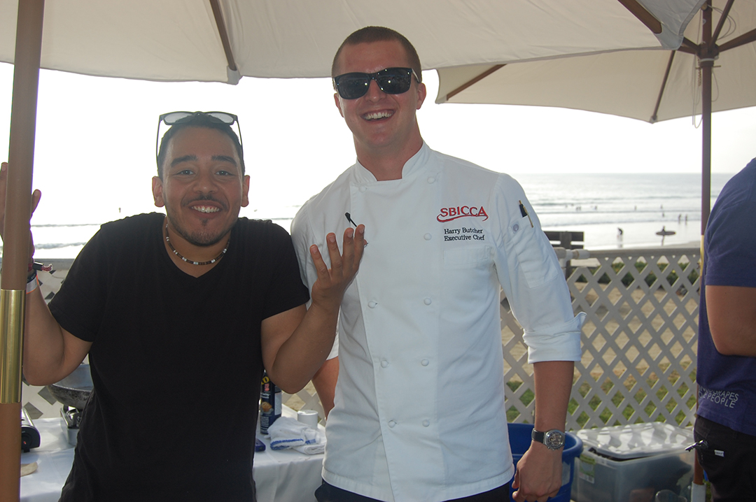 Logan Torres and executive chef Harry Butcher have some fun while creating Sbicca's carnitas tacos. Photo by Bianca Kaplanek