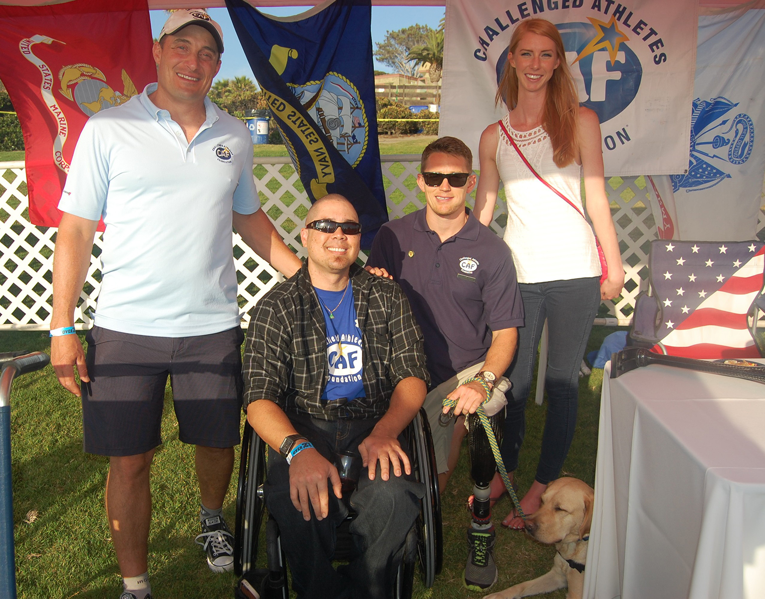 Holding down the information tent for the Challenged Athletes Foundation, a beneficiary of this year's event, are Solana Beach resident Nico Marcolongo, Mike Johnson, Mark Browne and Madeline Warr. Photo by Bianca Kaplanek