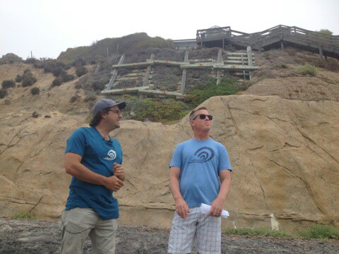 Mark West, left, and Tom Cook of the Surfrider Foundation lead a walking tour of seawalls in Encinitas on Monday. Photo by Aaron Burgin