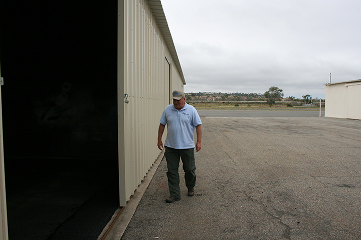 Rick Koehler, airport assistant manger, shows off refurbished hangars. Refurbishment is a fraction of the cost of rebuilding hangars. Photo by Promise Yee