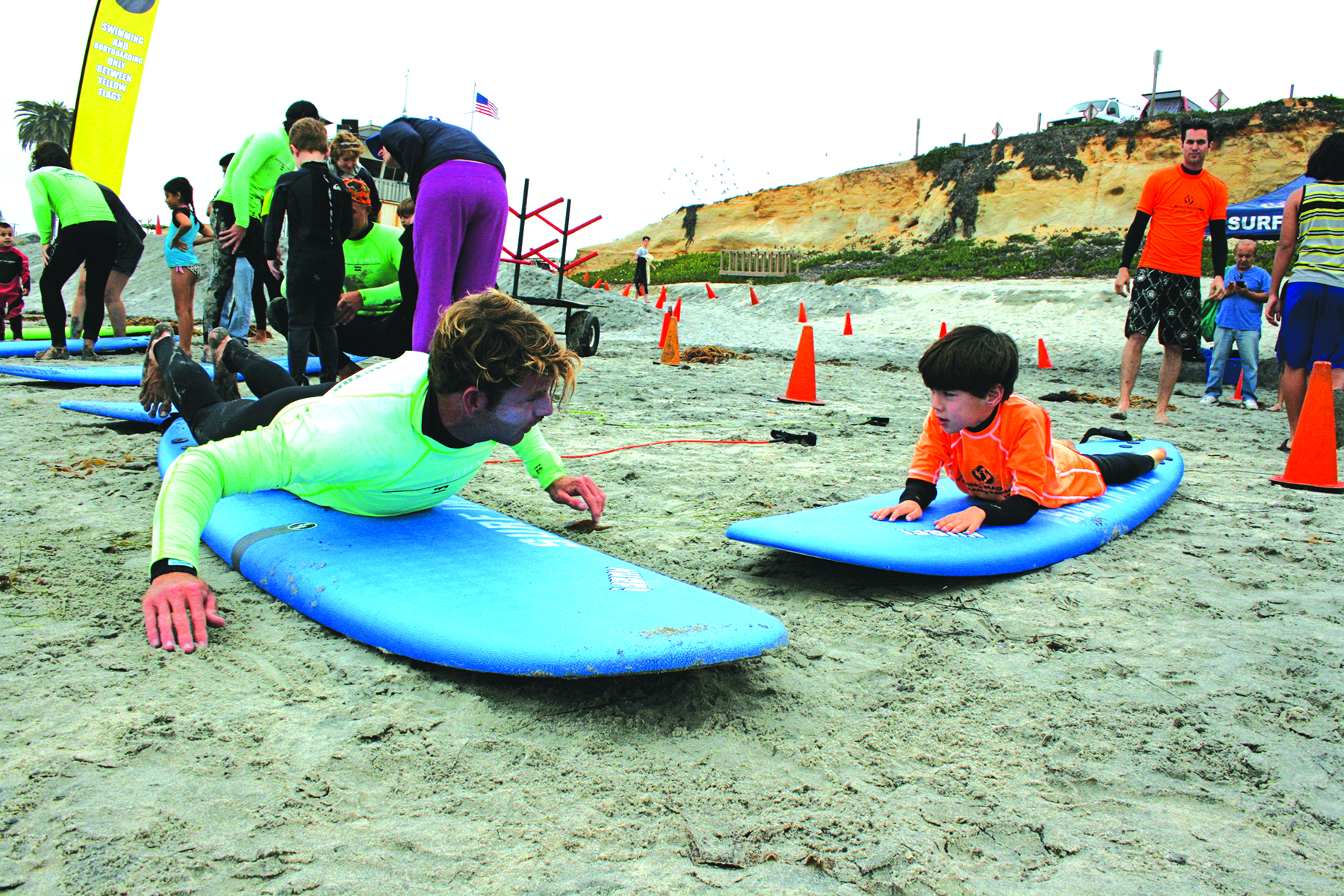Surf lessons bring smiles to youth, Wounded Warriors