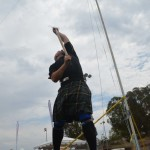 Ray McNeil participates in the sheaf toss competition on Saturday. Photo by Tony Cagala