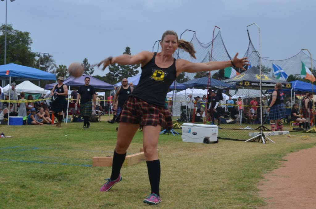 Holly Mersy hurls a weight in the lightweight toss. Photo by Tony Cagala