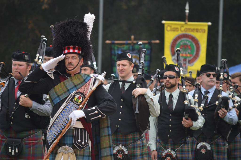 Members of the 42nd Black Watch Color Guard open the annual Scottish Highland Games and Gathering of the Clans event in Vista on Saturday. Photo by Tony Cagala