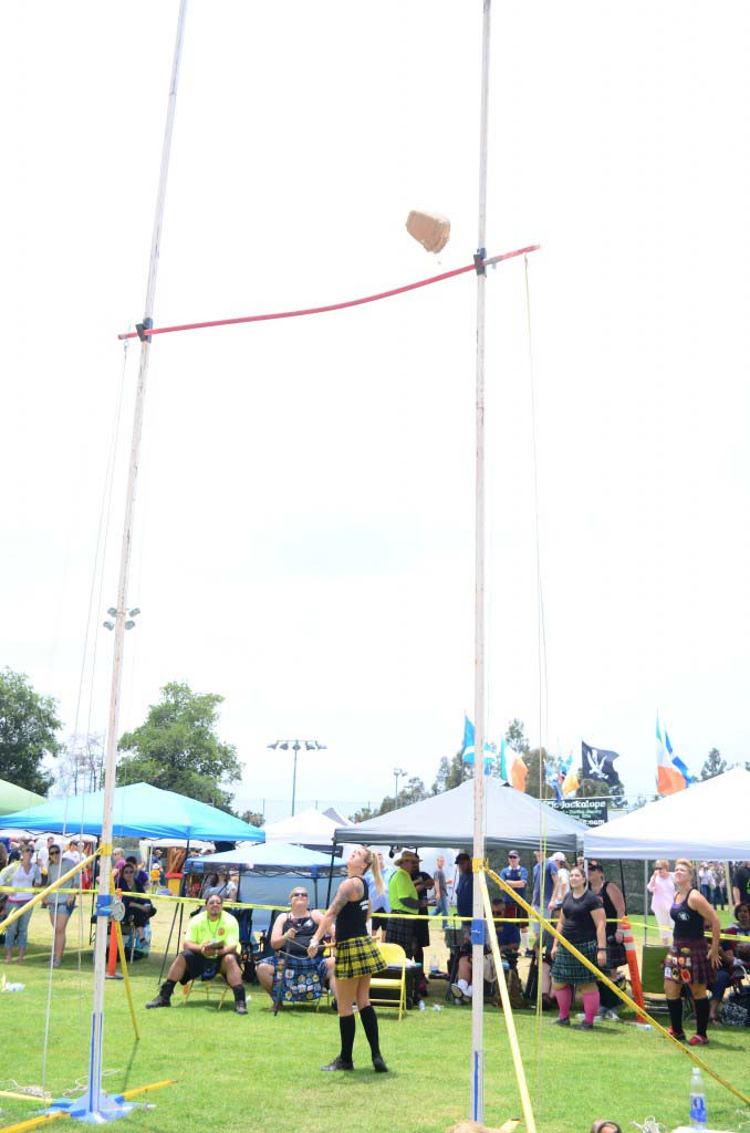 Felicia Fischer watches as her sheaf toss clears the bar. Photo by Tony Cagala