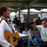 Brian Caldwell, singer of Highland Way, a traditional Scottish folk band, mixes it up with an enthusiastic crowd member. Photo by Tony Cagala