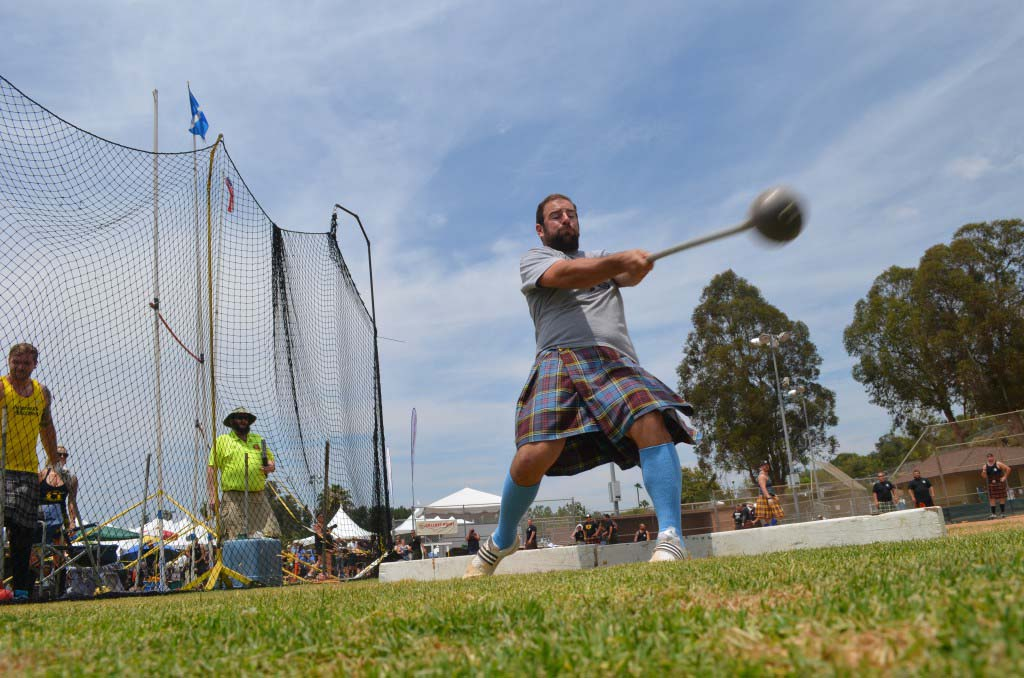 Hammer toss participants compete in the Scottish Highland Games. Photo by Tony Cagala