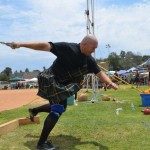 Ray McNeil spins and throws a weighted ball in the heavy weight toss event. Photo by Tony Cagala