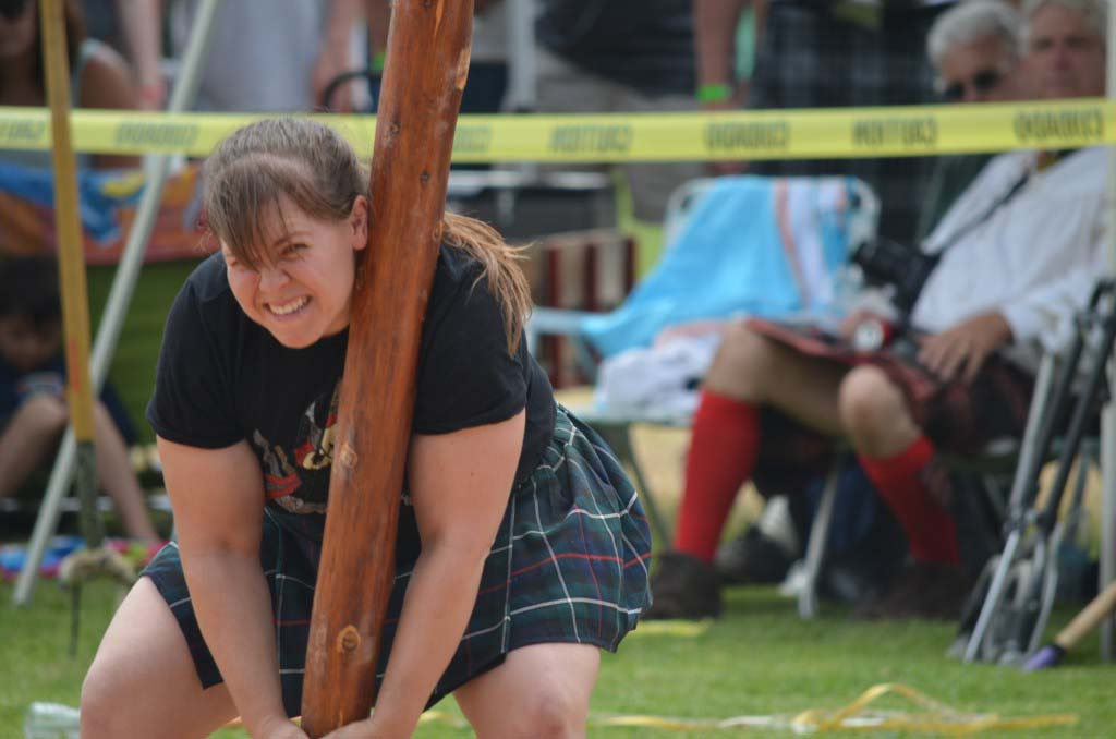 A competitor struggles to stabilize a 16-foot pole in the caber toss event. Photo by Tony Cagala