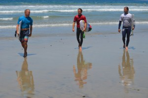 From left: Chris Cote, Nolan Rapoza and Damien Hobgood walk back in from their heat at Moonlight Beach. Photo by Tony Cagala