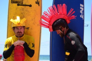 Competitors of the surf joust competition get their safety gear together. Photo by Tony Cagala