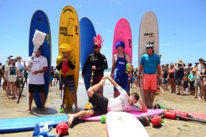 Some fun before the competitors in the surf joust competition paddle out. Photo by Tony Cagala