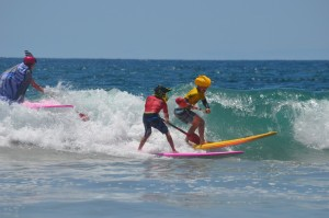 The fierce warriors battle fiercely in the fierce sea during the surf joust competition. Photo by Tony Cagala