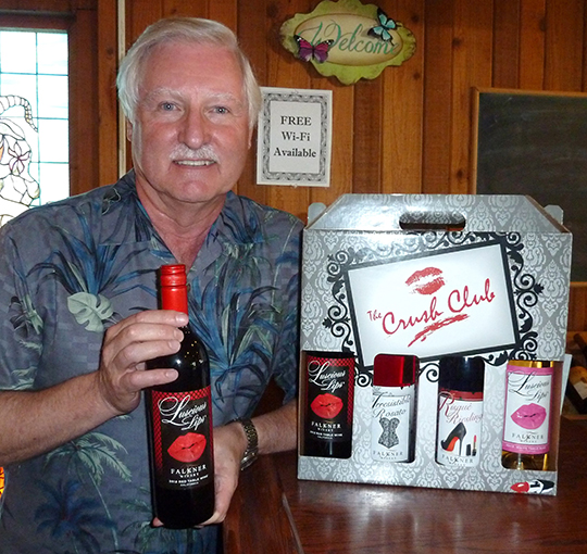 """Ray Falkner of Falkner Winery in Temecula with his Luscious Lips wine, part of a """"Seductive Series"""" four pack. Photo by Frank Mangio"""