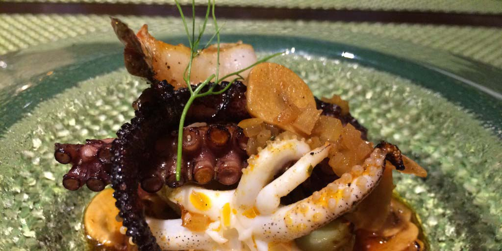 The spectacular grilled octopus at Arterra from new Executive Chef Evan Cruz. Photo by David Boylan