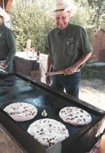 Wes House, owner of Winding River Resort near Grand Lake, Colo., cooks up giant pancakes at the weekend chuck wagon breakfast. Choose one or all of the 10 toppings, including blueberries, bananas, nuts and M&Ms. The pancake on the right is gluten-free.