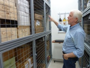 Alec White of San Diego Wine Storage points to typical safe, secure, temperature controlled locker space, with online inventory management. Photo by Frank Mangio