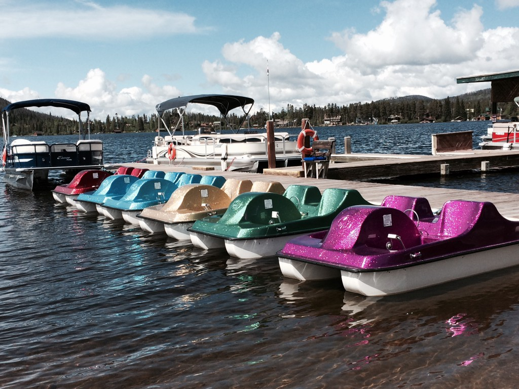 Early mornings, these sparkly watercraft are lined up at the dock at Grand Lake. Hotels, shops, boutiques, restaurants and some historic buildings that tell the history of this town are within walking distance.