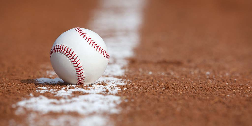 Baseball on the Infield Chalk Line. Stock Photo