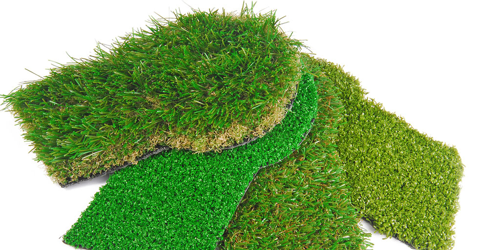 Artificial astroturf grass samples. Stock photo