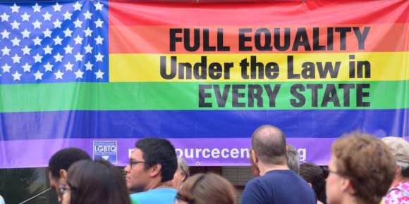 People at the LGBTQ Resource Center in Oceanside celebrate the Supreme Court's 2013 ruling over married homosexual couples receiving the same federal benefits as heterosexual couples. More celebrations rang out last week when the Supreme Court ruled that gay marriage was legal in all 50 states. File photo