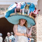 Rachel Burton of Del Mar shows off her hat in the paddock during opening day at Del Mar racetrack. Photo by Bill Reilly