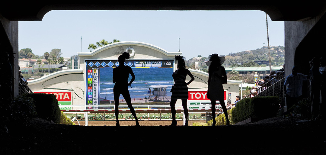 Spectators stop in the tunnel and look out to the scoreboard before the first race. Photo by Bill Reilly