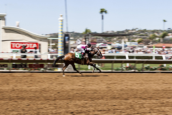 Always a Chance (5) ridden by jockey Tyler Baze crosses the finish line in first place during Race 2. Photo by Bill Reilly