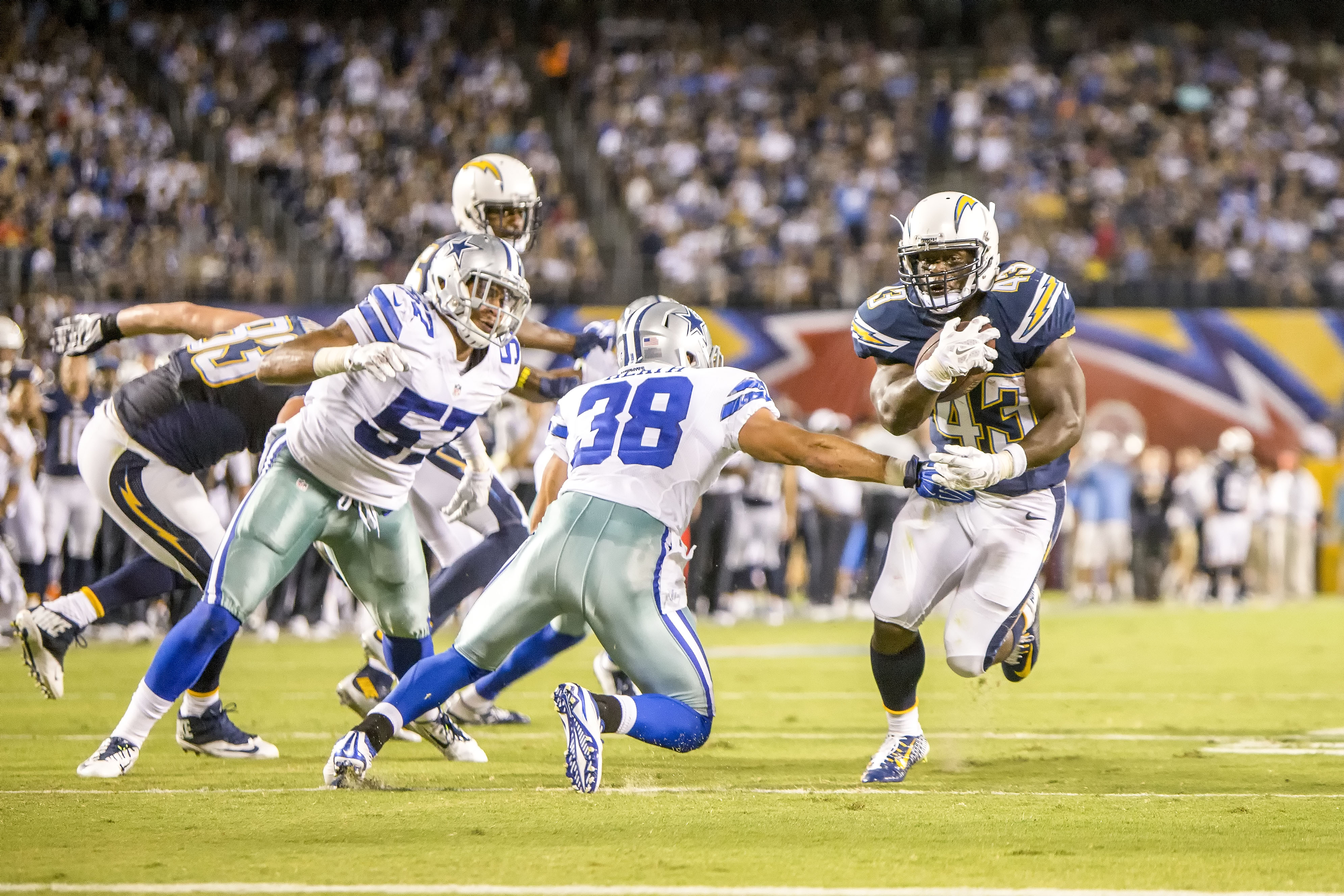 San Diego Chargers running back Brandon Oliver scores a touchdown in the second quarter of the game. Photo by Bill Reilly