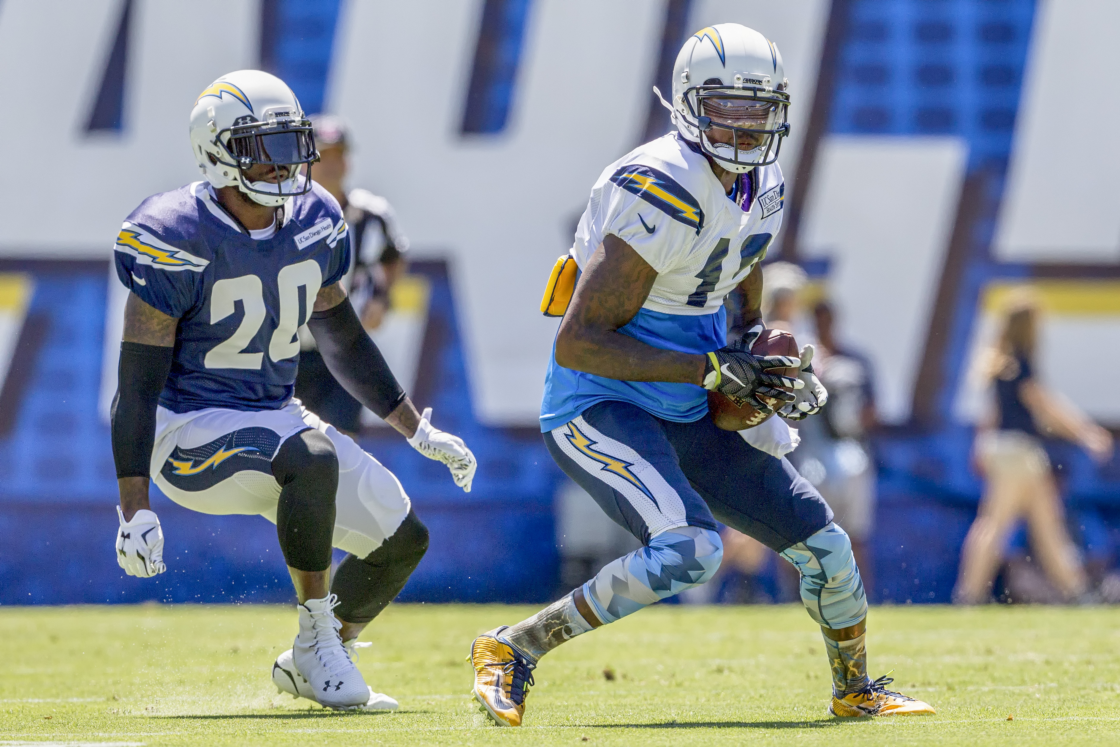 San Diego Chargers wide receiver Jacoby Jones (12) catches a pass in front of cornerback Chris Davis (20) during Fan Fest 2015 held at Qualcomm Stadium. Photo by Bill Reilly